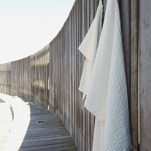 Waffle towels designed by The Organic Company. This soft and absorbent medium sized towel is available in a range of soft colours with a Scandinavian feel. Shown here in natural white.