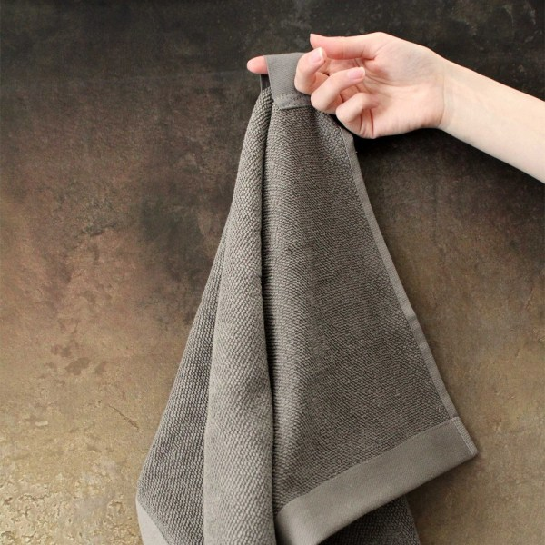Everyday organic hand towel by The Organic Company, in a choice of colours: dark grey, natural white, dark blue, sky, clay, pale rose