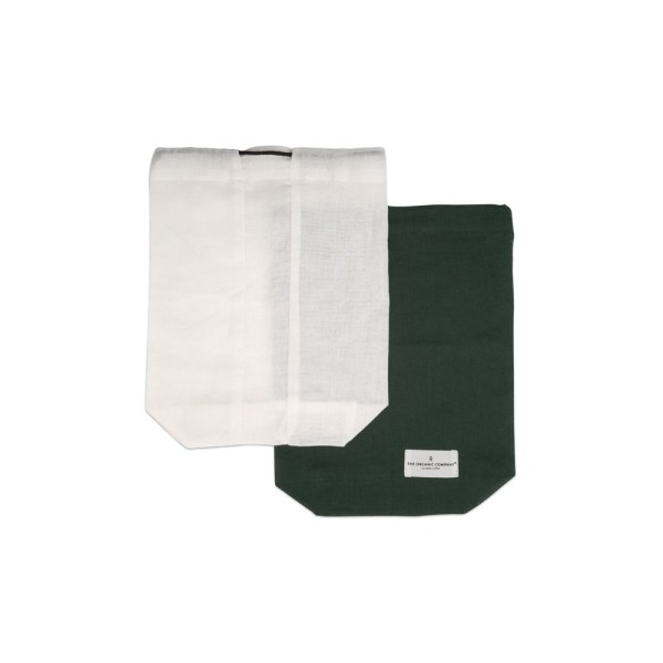 Food produce storage bag, keeping you away from plastics. Available in natural white or dark green in S/M/L (shown here in medium). By The Organic Company on Chalk & Moss (chalkandmoss.com). Nature connected homewares for wellbeing.