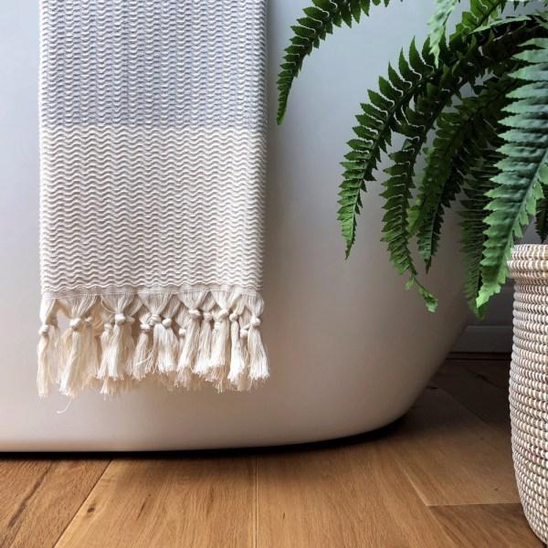 Lutti hammam towel in bath sheet size - 90 x 180 cm. Choose from mustard yellow, cobalt blue, black or pebble grey (seen here). Find it on chalkandmoss.com. Design by Luks Linen.