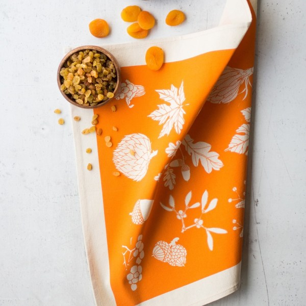 Cotton napkins in winter leaf print - 4 bright colours available for maximum hygge factor. This is the vibrant tangerine. By Softer + Wild on Chalk & Moss (chalkandmoss.com).