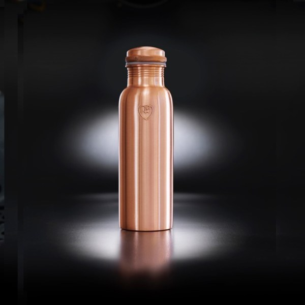 """Copper metal water bottle in a smooth matte texture. The """"Athlete"""" bottle has an extra wide mouth so you can drink easily and pop ice cubs inside. The pure copper naturally charges to water with antioxidant, anti-inflammatory and anti-microbial properties. This helps ease digestive and joint ailments, improves red blood cells, helps regenerate skin cells and more! Also available in hammered texture, all on Chalk & Moss (chalkandmoss.com)."""
