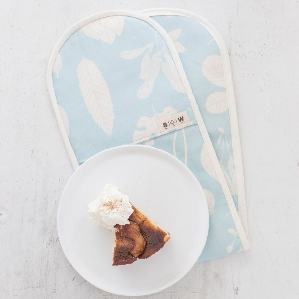 Blue oven gloves, perfect for your country style or modern Scandinavian kitchen. Designed by Softer + Wild, hand screen printed in Sussex. The colour resembles powder blue, turquoise or egg shell blue. Sold on chalkandmoss.com.