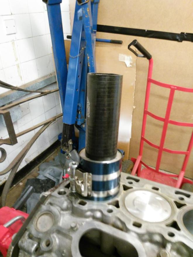 Using a section of hose to install pistons