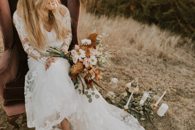 beautiful bride sat on hay bale