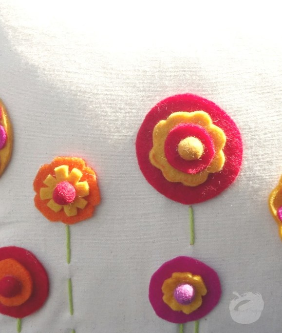 A close up of the finished felt flowers