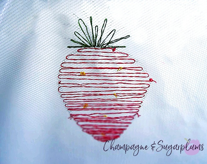 An embroidered strawberry on net by Champagne and Sugarplums