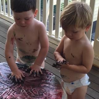 Boys finger painting