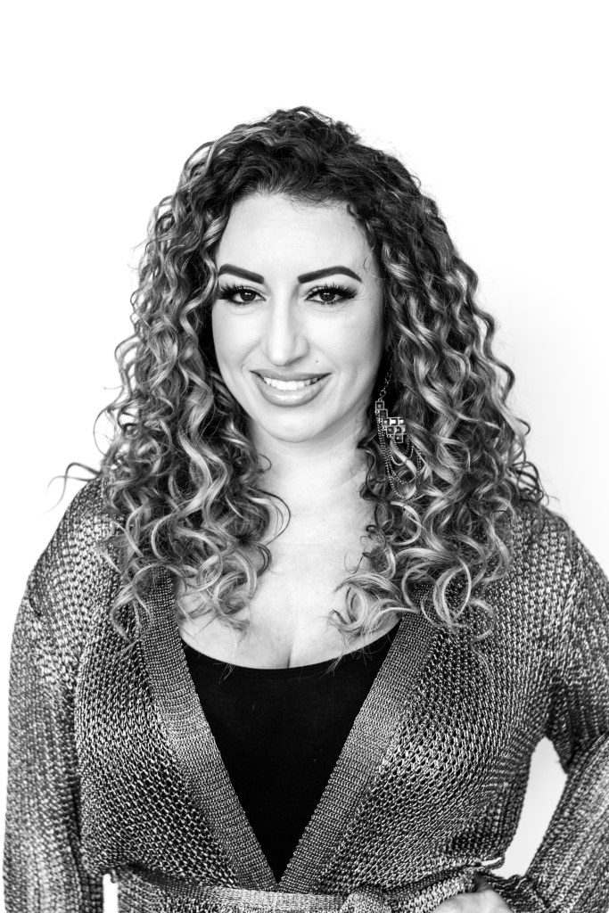 Karina is an Executive Stylist who specializes in curly hair at changes salon and day spa