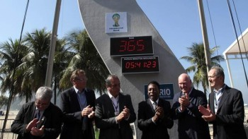 Officials attend the event marking one year to the kick-off of the 2014 FIFA World Cup at Copacabana beach in Rio de Janeiro