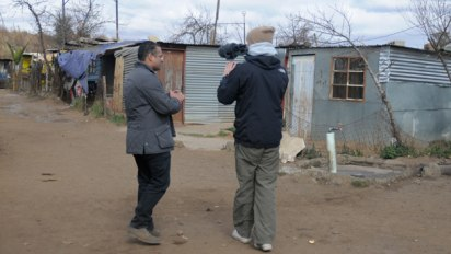 Krishnan Guru Murthy being filmed by Director Alex Nott in Kliptown