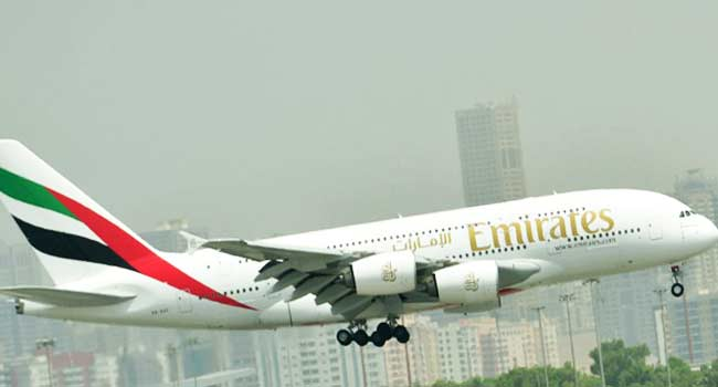 Emirates crew member who fell off a plane dies