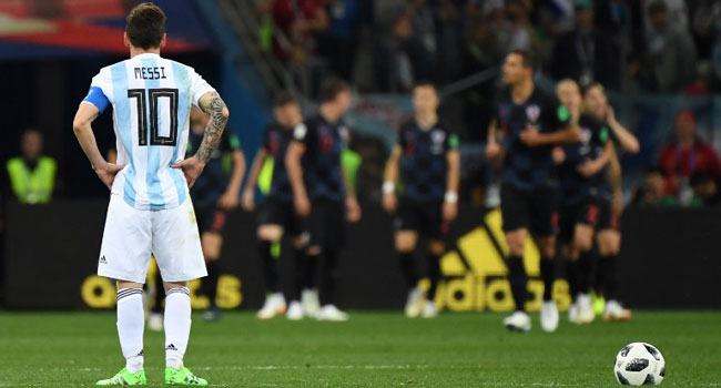 Argentina's forward Lionel Messi (2ndL) reacts after Croatia scored their third goal during the Russia 2018 World Cup Group D football match between Argentina and Croatia at the Nizhny Novgorod Stadium in Nizhny Novgorod on June 21, 2018. Dimitar DILKOFF / AFP