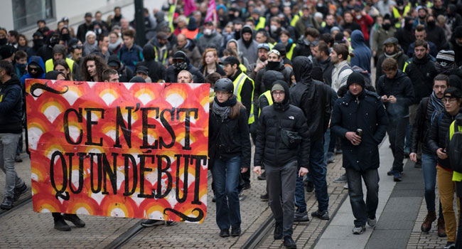 Crowds Hit Streets As French Pension Strike Stalls Transport