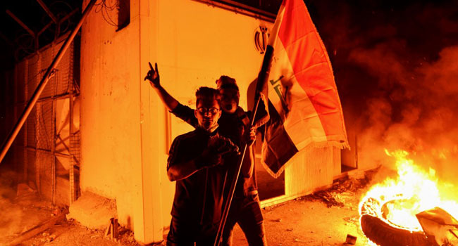 Iraqi Forces Kill 14 Protesters After Iranian Consulate Torched