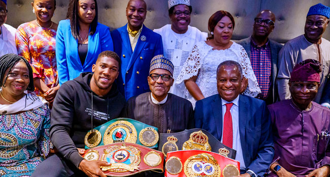 PHOTOS: Anthony Joshua Presents Heavyweight Titles To Buhari In UK