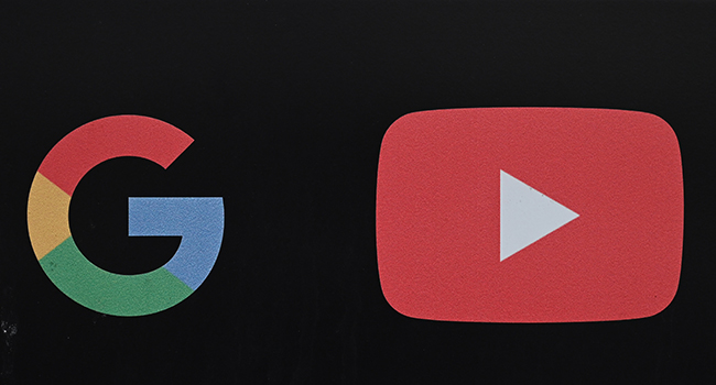 In this file photo taken on November 21, 2019, the Google and YouTube logos are seen at the entrance to the Google offices in Los Angeles, California. Alphabet is the parent company of Google and Youtube. Robyn Beck / AFP