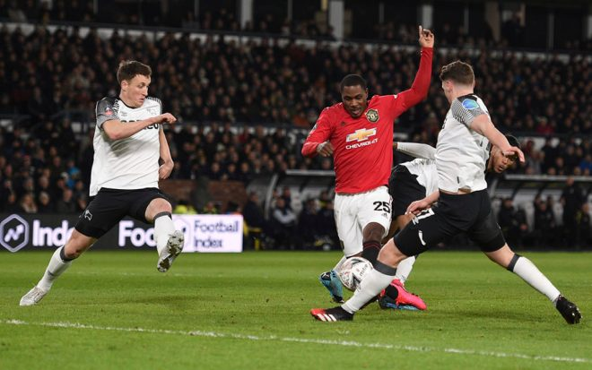 Manchester United's Nigerian striker Odion Ighalo scores his team's second goal during the English FA Cup fifth round football match between Derby County and Manchester United at Pride Park Stadium in Derby, central England on March 5, 2020. Photo: Oli Scarff / AFP