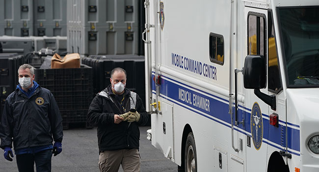 Members of the NYC Medical Examiner's Office at the site as workers build a makeshift morgue outside of Bellevue Hospital to handle an expected surge in Coronavirus victims on March 25, 2020 in New York. Bryan R. Smith / AFP