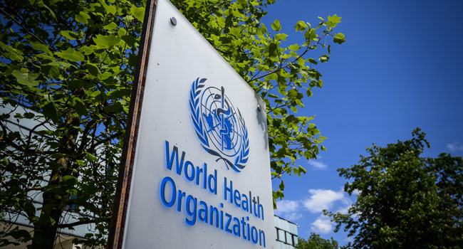 This picture taken on April 24, 2020 shows a sign of the World Health Organization (WHO) in Geneva next to their headquarters, amid the COVID-19 outbreak, caused by the novel coronavirus. Fabrice COFFRINI / AFP