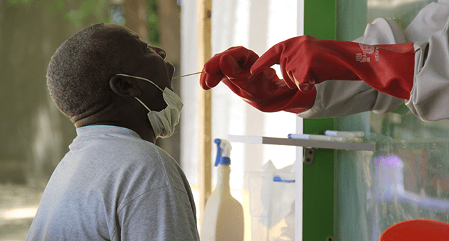 A patient who is suspected of suffering from COVID-19 coronavirus undergoes testing at the University of Maiduguri Teaching Hospital isolation centre on May 10, 2020. Audu MARTE / AFP
