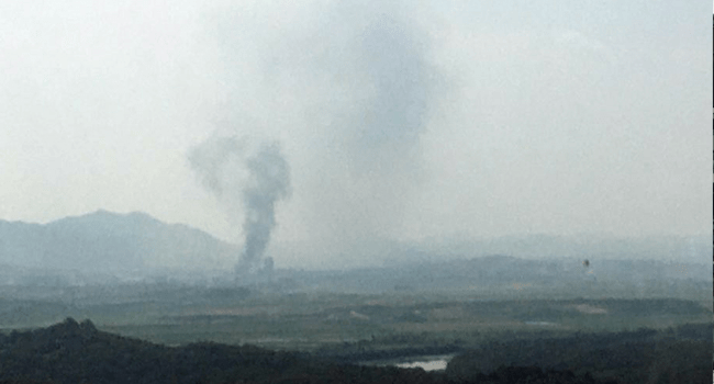 Smoke rise from North Korea's Kaesong Industrial Complex where an inter-korean liaison office was set up in 2018, as seen from South Korea's border city of Paju on June 16, 2020.  STR / YONHAP / AFP