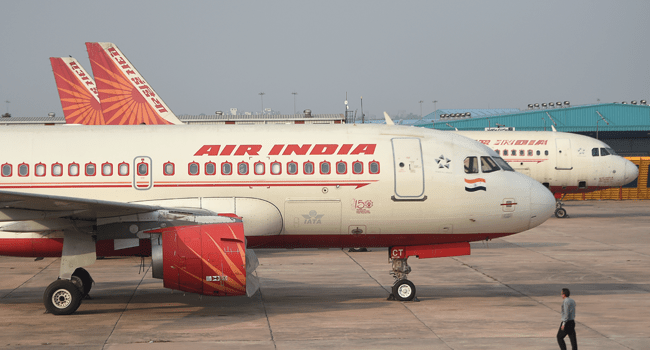 In this file photo taken on March 2, 2020 Air India planes are seen parked at the Indira Gandhi International airport, in New Delhi. Money SHARMA / AFP