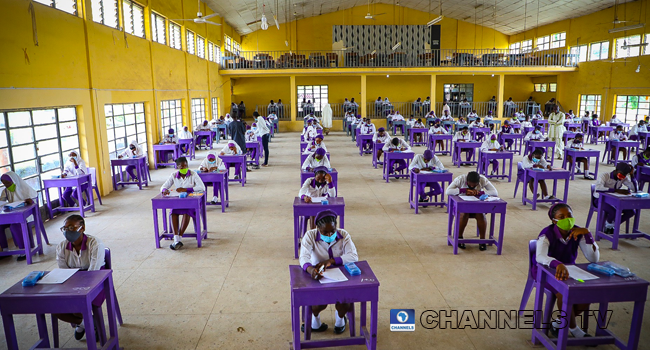 Wearing face-masks, final year students of Government Secondary School, Zone 3, Abuja, sit in a classroom as they write their West African Examinations Council exams, following the ease of COVID-19 lockdown order on Monday August 17, 2020. Photo: Sodiq Adelakun/Newspot.