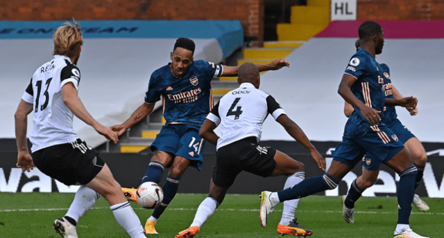 Arsenal's Gabonese striker Pierre-Emerick Aubameyang (2L) scores their third goal during the English Premier League football match between Fulham and Arsenal at Craven Cottage in London on September 12, 2020. Ben STANSALL / POOL / AFP