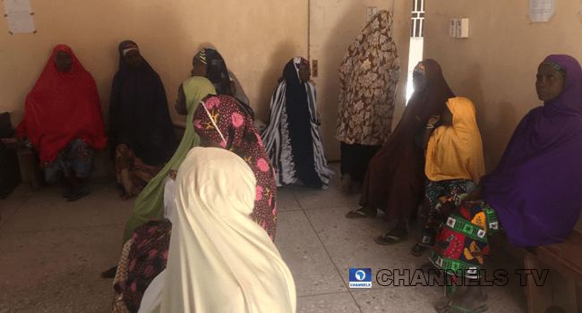 Women in a Jigawa community wait at a health centre.