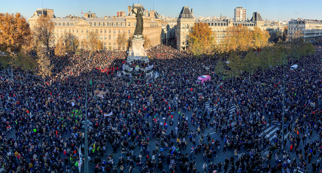 People gather on the Place de La Republique square in central Paris on November 28, 2020 for a demonstration against a new French law on global security which article 24 would restrict sharing images of police, only days after the country was shaken by footage showing officers beating and racially abusing a black man. Thomas COEX / AFP