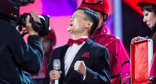 This file photo taken on November 10, 2015 shows Jack Ma (C), chairman of Alibaba Group, reacting during the 2015 Tmall 11.11 Global Shopping Festival gala in Beijing. STR / AFP