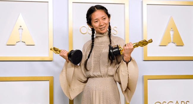"""Director/Producer Chloe Zhao, winner of Best Directing and Best Picture for """"Nomadland,"""" poses in the press room at the Oscars on Sunday, April 25, 2021, at Union Station in Los Angeles. Chris Pizzello-Pool/Getty Images/AFP"""