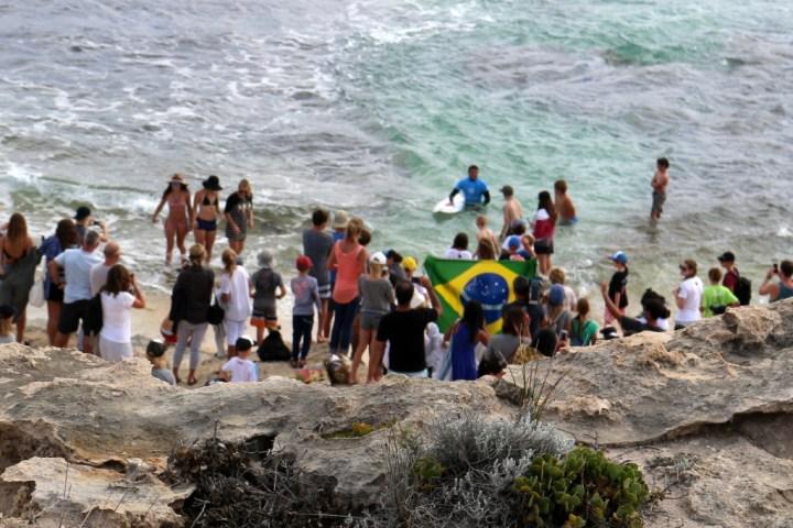 The crowd greets Adriano de Souza -- Brazilian flags and all