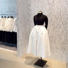 White skirt, black turtle neck Tijdelijk Modemuseum