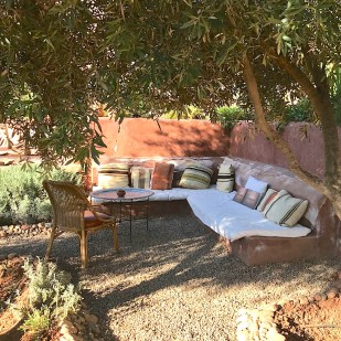 chapter fifty luxury travel morocco kasbah bab ourika garden couch