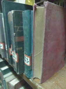 dusty volumes in the library - Frere Hall: Rediscovering The Old Town Hall
