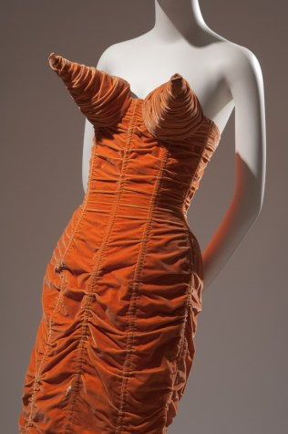 Jean Paul Gaultier, orange shirred velvet dress with cone bust and back lacing, 1984, France. The Museum at FIT, P92.8.1. Photo courtesy The Museum at FIT.