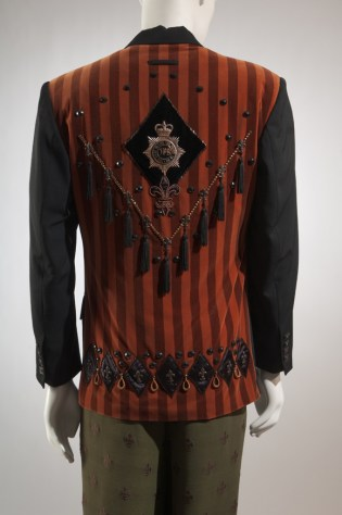 Jean Paul Gaultier, man's black wool gabardine and striped velveteen jacket with tassels, 1988, France. Museum at FIT, P88.76.4. Photo courtesy The Museum at FIT.