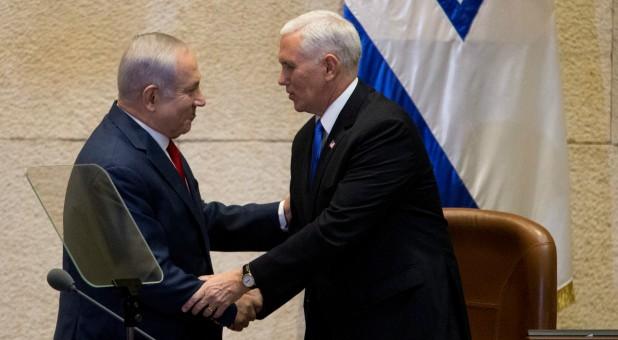 U.S. Vice President Mike Pence shakes hands with Israeli Prime Minister Benjamin Netanyahu.
