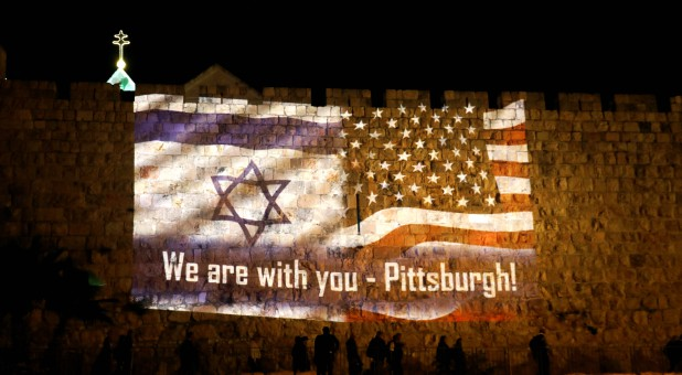 An image of Israeli and American flags with the wording,