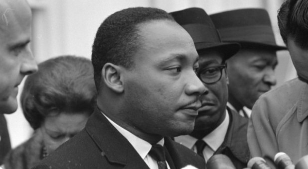 Martin Luther King Jr. speaks after meeting with President Lyndon B. Johnson to discuss civil rights at the White House in Washington, U.S., Dec. 3, 1963.