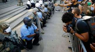 Will Police Officers' Kneeling Gesture Make a Difference?