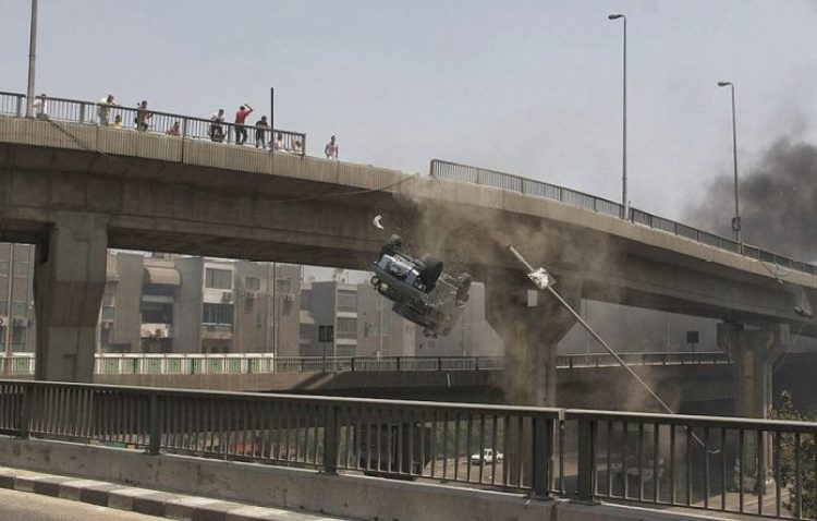 Fighting in the streets of Egypt. Armored car falls off the bridge