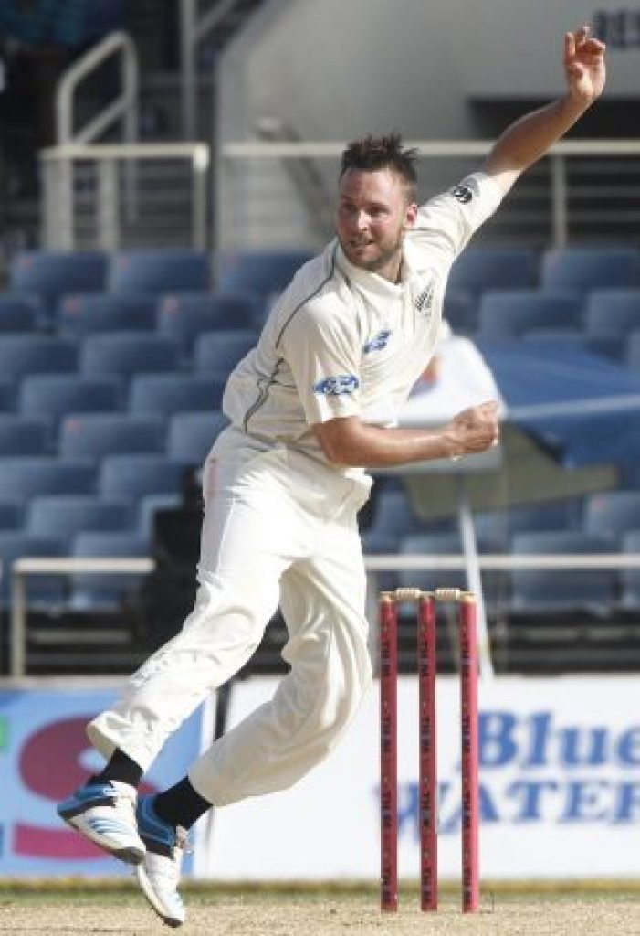 New Zealand's Mark Craig bowls during the second innings on the fourth day of their first cricket Test match against the West Indies in Kingston, Jamaica, Wednesday, June 11, 2014. (AP Photo/Arnulfo Franco)