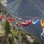 Fearless High-Liners in HAMMOCKS dangling 150ft above dizzying Alpine drops
