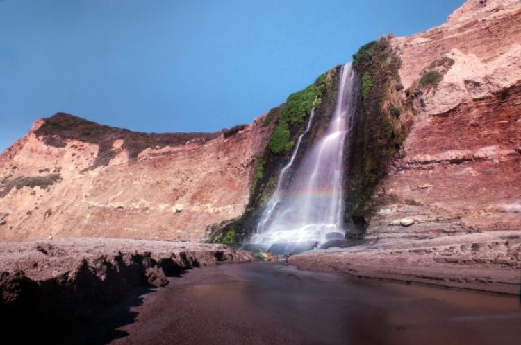 Once down at the beach, you will be treated to a wonderful experience, standing beside a 40 feet waterfall on the ocean.
