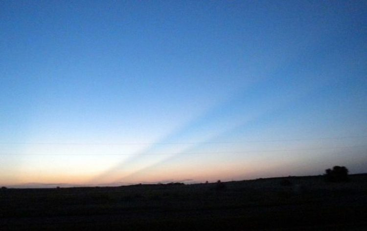 western Oklahoma and shows crepuscular rays caused by the Rocky Mountains, 250 km (160 mi) away