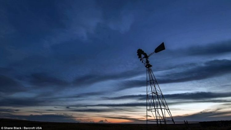 A lone windmill is silhouetted in Texas. Mr Blacks to multiple images of the same scene to create awesome timelapse video