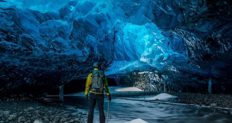 The caves take on an ocean-blue colour as the crystal clear ice takes on the colour of the sky